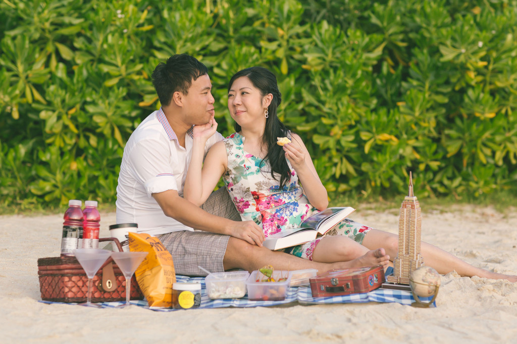 enjoying the food over a picnic at the beach food cooking prewedding photoshoot theme by