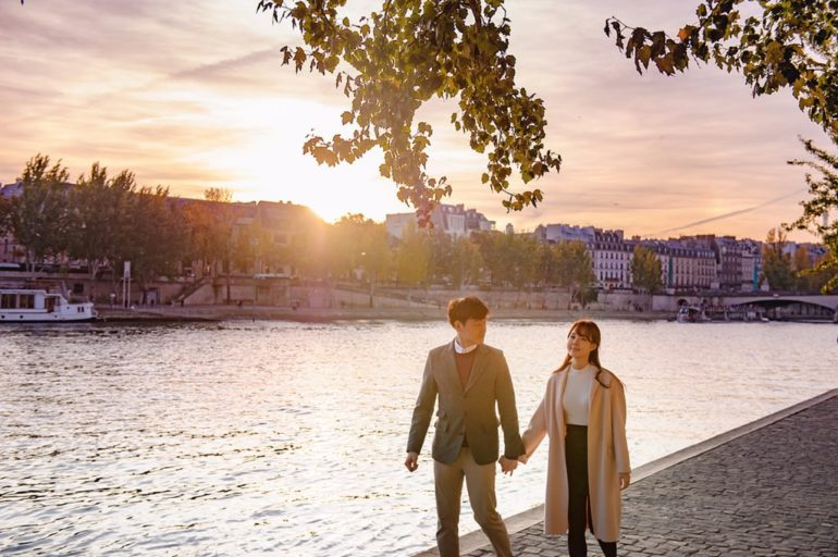 paris seine river sunset couple